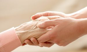 bigstock-Helping-hands-care-for-the-el-79418056